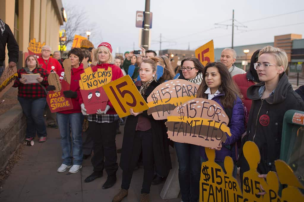 Fast food workers on strike for higher minimum wage and better benefits. Wage And Hour Rights.